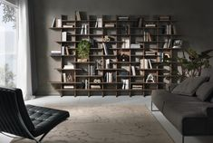 Elisabeth Pacini & Cappellini  Elisabeth, modular library wall with veneered walnut or wood fiber structure, shelves and dividers. Lightweight design and simple lines characterize this piece of furniture.  http://www.martinelstore.com/en/prod/bookcase/elisabeth-pacini-cappellini.html