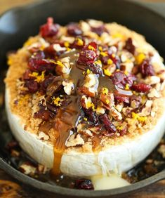Cranberry Pecan Baked Brie Recipe – creamy gooey cheese topped with tarty cranberries and sweet toasted pecans. Perfect party appetizer for the holiday season!    In my book, appetizers almost always have to include cheese. Best yet,