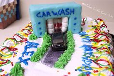 love the idea of mini marshmallows and fruit strips or gum strips as the scrubbers in this car wash cake