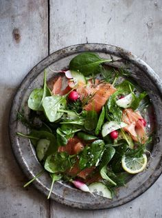spinach and smoked salmon salad with lemon dill dressing. /