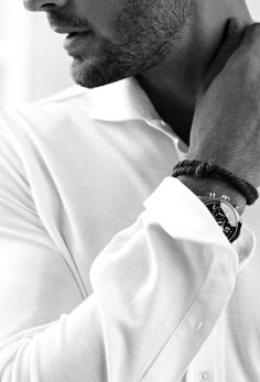 first, a crisp white shirt, slightly unbuttoned, folded back cuff. then... bam! a watch.  boom! a simple braided leather bracelet.