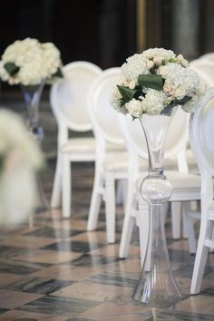 Elegant aisle marker idea - tall glass vases with hydrangeas + pink roses {Focus Production}