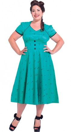 The flirty all over print of martini glasses looks amazing on this pretty teal cotton dress! #blamebetty #swingdress #pinupstyle