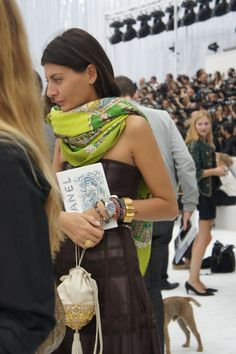 Giovanna Battaglia designer branded in Hermes cashmere Peperoles in vert anis & Rolex wristed at Chanel