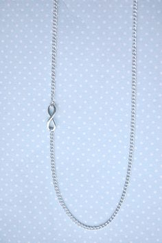 Infinity symbol - long silver necklace by otterlydesign on Etsy, $21.49  A sweet and fun silver necklace with an infinity symbol on a long silver chain that looks great both with a casual outfit or on a party.