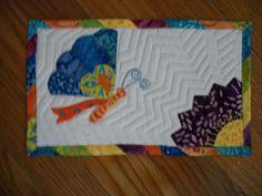 Modern quilted mug rug.