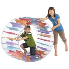 The Play Wheel is a inflatable wheel that kids can use indoors or outdoors. Kids can roll or tumble inside the colorful Play Wheel. The transparent base allows kids to see where they are going if they choose to roll around inside the Play Wheel. Physical Activities, Activities For Kids, Inflatable Furniture, Outdoor Fun, Outdoor Stuff, New Toys, Cool Toys, Little Ones, Kids Toys