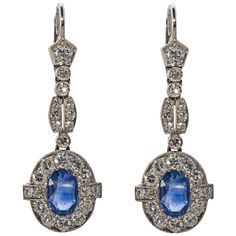 Sapphire Diamond Platinum Earrings | From a unique collection of vintage dangle earrings at https://www.1stdibs.com/jewelry/earrings/dangle-earrings/