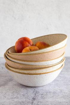 Wide, shallow bowls that are great for serving salads and pasta family-style, or for holding fruit. Features an unglazed lip and a decorative swirl in the center of the bowl. These bowls are lightweight but sturdy and are dishwasher and microwave safe. Cocktail Mix, Kitchen Must Haves, Peach Blush, Color Glaze, White Clay, Salad Bowls, Ceramic Bowls, Serving Bowls, Ceramics