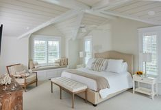 Different shades of white plus plenty of texture make this all white room anything but boring.
