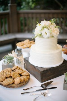 White floral topped wedding cake: http://www.stylemepretty.com/california-weddings/encinitas/2015/11/18/high-school-sweethearts-casual-elegant-san-diego-botanical-garden-wedding/ | Photography: Heidi-o-photo - http://heidiophoto.com/