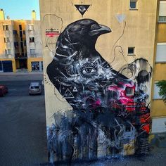 regram @urbannationberlin Fits my thoughts these days great wall by @17matrix ....guardiaõ dos esquecidos .. guardian of those forgotten ...In Loures Portugal #urbanart #urbannation #streetart #movement #artivism #graffiti #mythical #crow #raven #messenger #painting