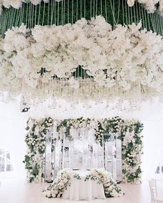 Greenery and white blooms galore! | Photography By: Konstantin Semenikhin Photography | WedLuxe Magazine | #WedLuxe #Wedding #luxury #weddinginspiration #luxurywedding #weddingflowers #whitewedding #gardenwedding #weddingceremony