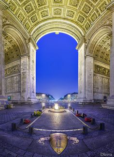 "The Arc de Triomphe ~""Triumphal Arch"" in Paris honors those who fought and died for France. At this site there burns an eternal flame in memory of the dead who were never identified in either world war."