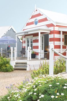 Red and white coastal stripe beach hut