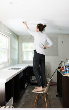 To determine how far apart to space recessed lights, divide the height of the ceiling by two. If a room has standard 8 foot ceilings, like our home, the recessed lights should be approximately 4 feet apart. So, if the ceiling is 10 feet, you'll want to put about 5 feet of space in between each fixture, make sense?