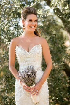 Gorgeous up-do and embellished dress! View the full wedding here: http://thedailywedding.com/2015/11/21/vibrant-lavender-wedding-maranda-rob/