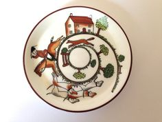 Mom had a cup and saucer in this pattern...out of all the collection of teacups she had, this is the only one I remember. I love it! Coalport Hunting Scene Coaster or Pin Dish by JanvierRoad on Etsy