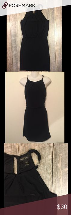 WHBM black circle neck dress WHBM black circle neck dress. Silver accents on neck. Elastic waistband. Polyester spandex. button behind neck.36.5 inches long. Tag reads XXS White House Black Market Dresses