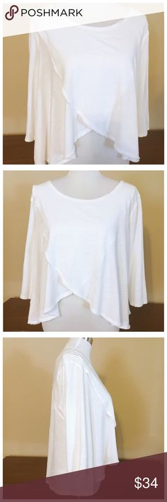 """Free People Wrap Cross Front Cotton Crop Top XS Free People - We The Free - Wrap Cross Front Cotton Crop Top --- size XS --- 100% cotton --- cross front top has 3/4 sleeves and raw hems --- the two front panels cross and bares your belly button in a peek-a-boo manner --- the cotton fabric is slightly textured and feels like a linen cotton blend --- 21"""" bust --- 24"""" back length --- 21"""" front length --- this top is in very good  pre-loved condition, and shows no signs of wear or imperfections…"""