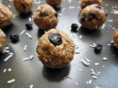 Energy balls made with oats, coconut, dried blueberries and almond butter with protein powder for a protein boost! A great vegan and gluten free snack.