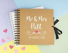 This personalised Mr & Mrs (Mr and Mrs) scrapbook (memory book or photo album) features the name of the happy couple, as well as the date of their wedding day. Please add the names and date in the personalisation box. This makes a perfect photo album (just add photo corners), or a guest book for