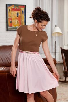 change-up the skirt of a dress by adding a functioning zipper and creating many skirts for the top.