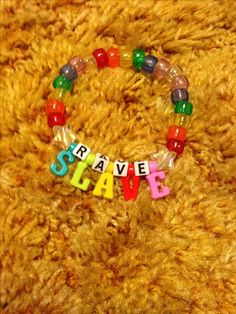 """RAVE SLAVE"" Rainbow Kandi (copied from Pinterest)"