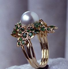 South Sea Pearl ring surrounded with pave' set emerald encrusted repousse hand formed grape leaves and Emerald Grape Clusters.
