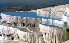 This is NOT ice. These are mineral water falls!! The water is so heavy with minerals that it creates stalagtite like formations over the years as it flows.