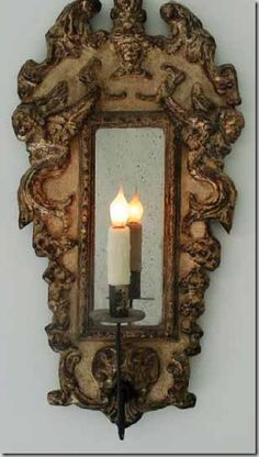 Chateau Domingue; electrified mirrored sconce