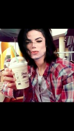 It says Peter pan on the cup because Michael believed that he was the modern day Peter pan