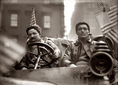"""February 1908. """"Lelouvier and driver in Werner car, at start of New York to Paris automobile race."""" The course was from Times Square to the Eiffel Tower via Alaska and Siberia."""