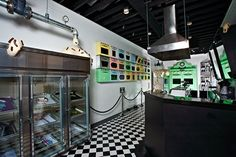Johnny Cupcakes stores are designed as a kind of trickery with classic bakery motifs but they actually sell T-shirts and other trinkets that are displayed inside glass pastry cases.