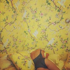 Play With Patterns and Prints. Yellow floral wallpaper.