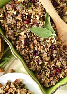 Best Ever Wild Rice Stuffing is full of fall flavors like herbs, bacon, mushrooms, parmesan, dried cranberries, almonds, and garlic. A delicious side for the holidays.