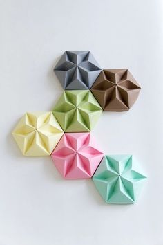 From Studio Snowpuppe. Blogged: www.allthingspaper.net/2013/04/origami-ceiling-roses-stud...
