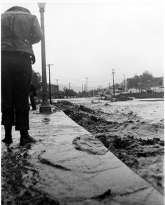 Rushing waters during a flood in Glendale, in front of the Adams Square Apartments looking east, February 20, 1941. Glendale Central Public Library. San Fernando Valley History Digital Library