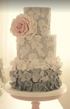 Featured Cake: Cotton & Crumbs; Elegant three tier white floral detailed grey wedding cake