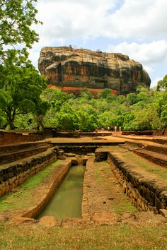 The Sigiriya Rock seen from the Fountain Gardens ~ Central Province, Sri Lanka Places Around The World, Oh The Places You'll Go, Places To Visit, Around The Worlds, Le Sri Lanka, Tourist Spots, Wonders Of The World, Beautiful Places, Amazing Places