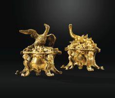 Paire de chenets à la Salamandre et au Phénix en bronze doré d'époque Régence - Sotheby's
