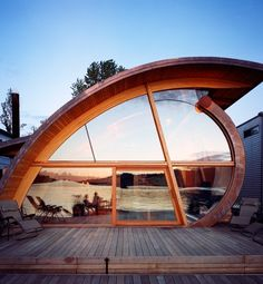 The unique shape of this Portland floating house by architect Robert Harvey Oshatz reflects the curves of the Columbia River on which it sits.