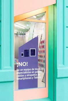 """Doctor Manzana mobile store by Masquespacio, Valencia – Spain » Retail Design Blog Looking at the store everything starts from the striking façade that incorporates the same angles and colors like for the graphic identity. The blue and green colors like a reference to the doctor, the salmon color for the fashionistas and the purple for the freaks. Both windows contain texts like """"Doctor Manzana? Is it an orthopedic doctor? No! It's a team of technicians specialized in smashes, drops and…"""