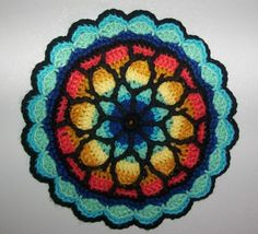 Handmade crochet Stained Glass look potholder - this uses the same base pattern I used to make my afghan, with the addition of the edging, makes a nice mandala