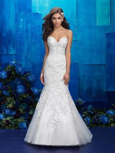 Gorgeous lace appliques are the perfect accompaniment to such a classic silhouette.