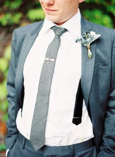 Love the grey tie w/clip and the bluish grey suit. These look good on any guy