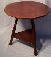 Antique Cushman colonial creations maple wood round table. 25 1/2 inches tall.