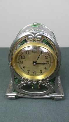 A pewter and enamel Arts and Crafts mantle clock