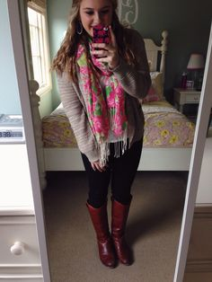 Love her outfit and the pop if color in the scarf. And her room!