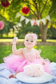 1 year cake smash session for a little girl... Complete with pink tutu, poms, bunting and a custom rosette cake! Love! © 2013 www.studiowestway.com